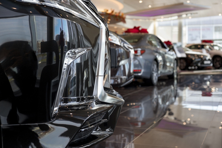 New cars at dealer showroom. For use as a background. Modern and prestigious vehicles.