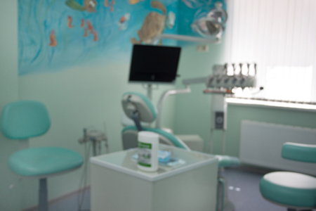 Dental treatment unit and other equipment with blur background. Dentist office. Healthy lifestyle.