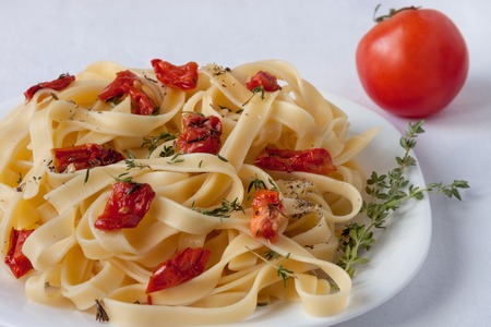 Fettuccine pasta with sun-dried tomatoes and rosemary. Close up. Healthy lifestyle. Stock Photo
