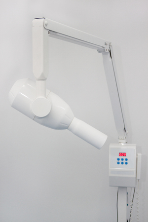 X-ray machine in the dental clinic isolated on a white background. Dentist office. Healhcare and medicine. Stock Photo