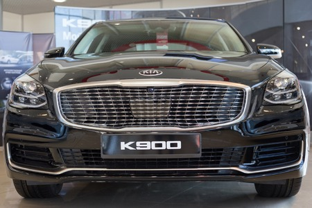 Russia, Izhevsk - April 4, 2019: New car premium class in dealer showroom. New KIA K900. Famous world brand. Modern transportation. Editorial