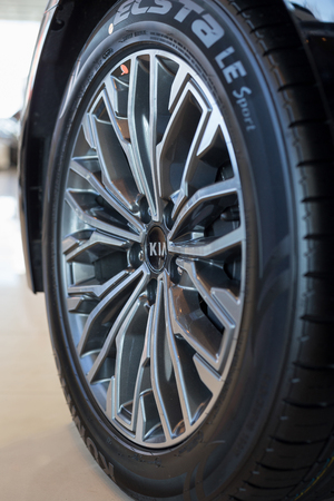 Russia, Izhevsk - April 4, 2019: Showroom KIA. The wheel with alloy wheel of a new car. Famous world brand. Modern transportation. Editorial