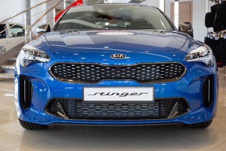 Russia, Izhevsk - April 4, 2019: Showroom KIA. New sports car Stinger in dealer showroom. Modern and prestigious vehicles.