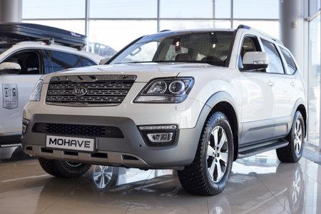 Russia, Izhevsk - April 4, 2019: New cars in the KIA showroom. Modern KIA Mohave. Famous world brand. Prestigious vehicles.