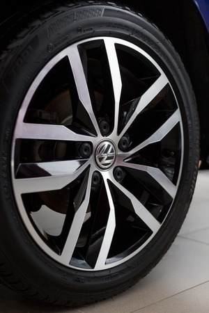 Russia, Izhevsk - February 15, 2019: Showroom Volkswagen. The wheel with alloy wheel of a new Volkswagen car. Famous world brand.