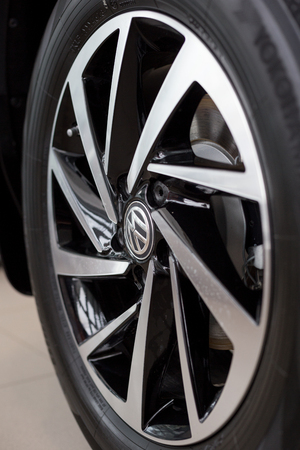 Russia, Izhevsk - February 15, 2019: Showroom Volkswagen. The wheel with alloy wheel of a new car. Famous world brand.
