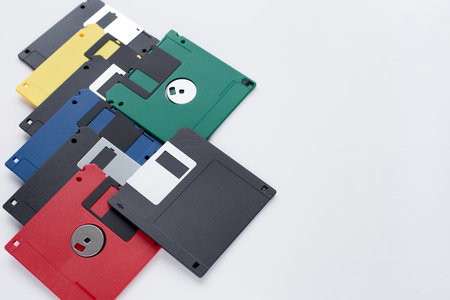 Group of multi-colored flexible disks isolated on a white background. Retro style.