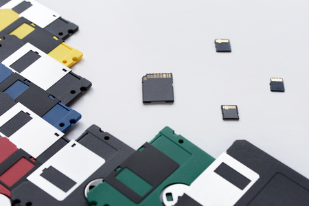 The evolution of digital data storage device. Floppy disks and memory cards isolated on a white background. Stock Photo