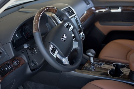 Russia, Izhevsk - February 15, 2019: Showroom KIA. Interior of new car KIA Mohave with automatic gearbox. Famous world brand. Modern transportation.