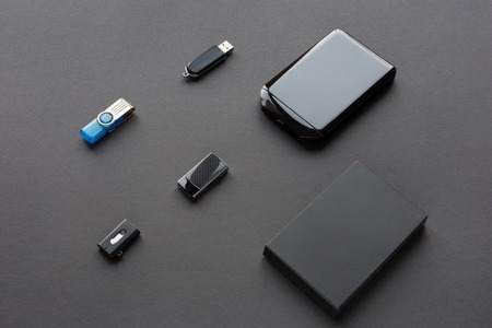 Modern digital devices for the transfer and storage of information. Flash drives and external hard disks.
