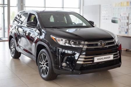Russia, Izhevsk - July 18, 2019: New cars in the Toyota showroom. Modern Highlander. Famous world brand. Prestigious cars.