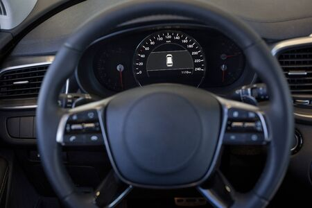 Dashboard and steering wheel of new modern car. For use as a background.