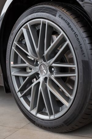 Russia, Izhevsk - October 10, 2019: Hyundai showroom. The wheel with alloy wheel of a new Genesis G70. Standard-Bild - 134500756