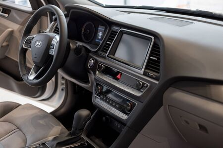 Russia, Izhevsk - October 10, 2019: Hyundai showroom. Interior of new modern Sonata car with automatic transmission. Famous world brand. Standard-Bild - 134500820