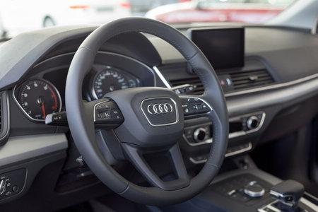 Russia, Izhevsk - September 11, 2019: Audi showroom. Interior of new Q5 Quattro with automatic transmission in dealer showroom. Famous world brand. Modern transportation. Standard-Bild - 134500845