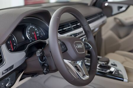 Russia, Izhevsk - September 11, 2019: Audi showroom. Interior of new Q7 Quattro with automatic transmission in dealer showroom. Famous world brand. Modern transportation. Standard-Bild - 134500847