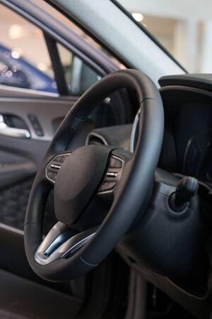 Interior and steering wheel of new modern car. For use as a background. Reklamní fotografie