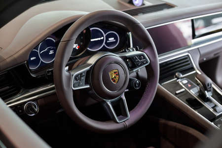 Russia, Izhevsk - August 04, 2020: Porsche showroom. Interior of modern car business class Panamera 4. Volkswagen Auto Group. Prestigious vehicles.