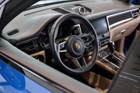 Russia, Izhevsk - August 04, 2020: Porsche showroom. Interior of new Macan S car. Volkswagen Auto Group. Famous world brand.
