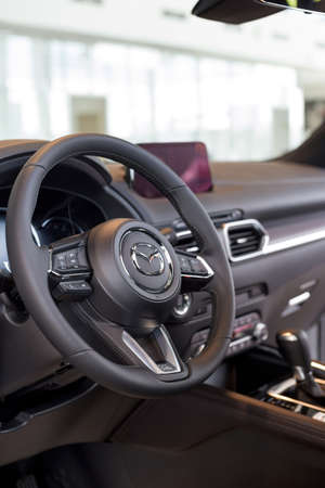 Russia, Izhevsk - August 06, 2020: Mazda showroom. Interior of new Mazda CX-5 car with automatic transmission. Famous world brand.