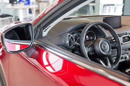 Russia, Izhevsk - August 06, 2020: Mazda showroom. Steering wheel and interior of new Mazda CX-5 car. Famous world brand. Prestigious vehicles. Éditoriale
