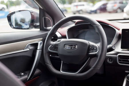 Russia, Izhevsk - August 14, 2020: Geely showroom. Steering wheel and interior of new modern CoolRay car. Car manufacturer from China.