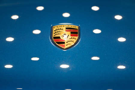Russia, Izhevsk - August 04, 2020: Logo of Porsche brand in the dealer showroom. Volkswagen Auto Group. Car manufacturer from Germany.