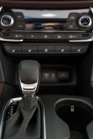 New modern unknown car with automatic transmission. Modern transportation. Close up. Standard-Bild