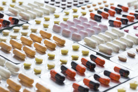Packagings with pills close up. Production and sale of medical preparations. Business, finance concept. Cost of the healthy life. Modern healthcare and medicine.