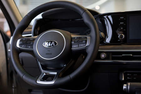 Russia, Izhevsk - December 28, 2020: KIA showroom. Steering wheel and interior of new K5 car business class. Famous world brand. Editorial