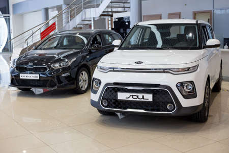 Russia, Izhevsk - December 28, 2020: KIA showroom. New Ceed SW and Soul in dealer showroom. Front and side view. Famous world brand.