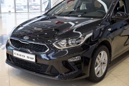 Russia, Izhevsk - December 28, 2020: KIA showroom. New Ceed SW car in dealer showroom. Cropped image. Famous world brand. Editorial
