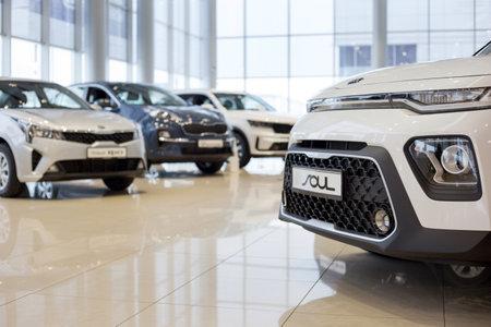 Russia, Izhevsk - December 28, 2020: KIA showroom. New modern cars in the dealer showroom. Famous world brand. Prestigious vehicles. Editorial