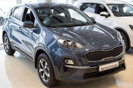 Russia, Izhevsk - December 28, 2020: KIA showroom. New Sportage car in dealer showroom. Front and side view. Famous world brand. Editorial