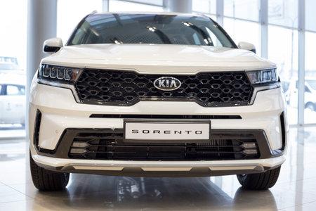 Russia, Izhevsk - December 28, 2020: KIA showroom. New Sorento car in dealer showroom. Front view. Prestigious vehicles.