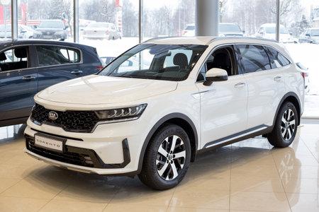 Russia, Izhevsk - December 28, 2020: KIA showroom. New Sorento car in dealer showroom. Front and side view. Prestigious vehicles.