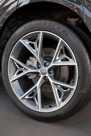 Russia, Izhevsk - September 11, 2019: Audi showroom. The wheel with alloy wheel of a new Q7 Quattro. Volkswagen Auto Group. Famous world brand. Editorial