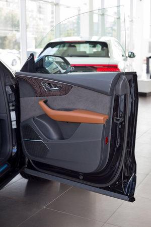 Russia, Izhevsk - September 11, 2019: Audi showroom. Details of car door new Q8 Quattro. Famous world brand. Modern transportation.