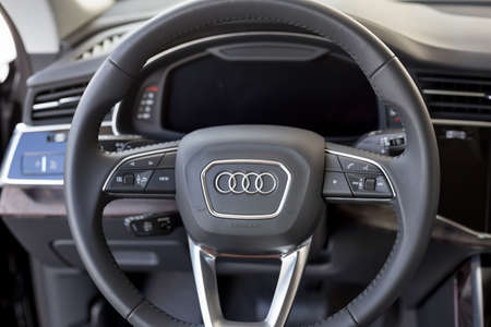 Russia, Izhevsk - September 11, 2019: Audi showroom. Steering wheel and interior of new Q7 Quattro. Volkswagen Auto Group. Famous world brand.