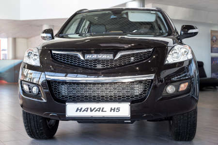 Russia, Izhevsk - February 17, 2021: Haval showroom. New modern Haval H5 car in dealer showroom. Front view. Car manufacturer from China.