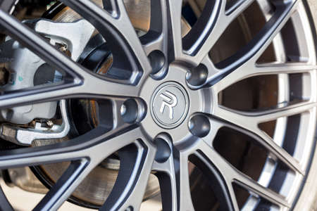 Russia, Izhevsk - February 17, 2021: Haval showroom. The part of alloy wheel new Haval F7X car. Cropped image. Car manufacturer from China. Modern transportation. 新聞圖片