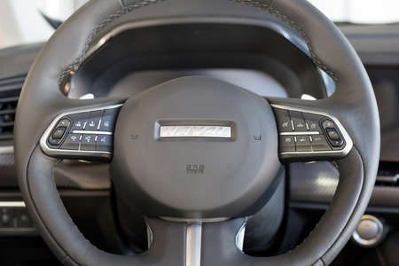 Russia, Izhevsk - February 17, 2021: Haval showroom. Steering wheel of new Haval F7X car with leather cover. Car manufacturer from China.