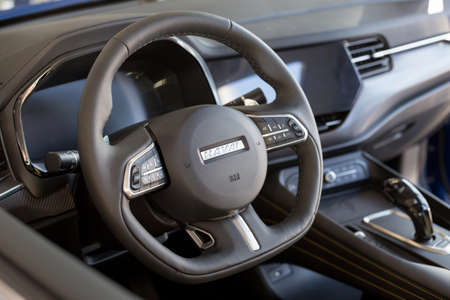Russia, Izhevsk - February 17, 2021: Interior of new modern F7X car in Haval showroom. Car manufacturer from China. Modern transportation. 新聞圖片
