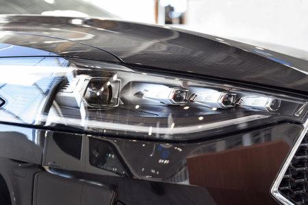 Russia, Izhevsk - February 17, 2021: Haval showroom. New modern F7X car with elegant headlights. Car manufacturer from China. Modern transportation.