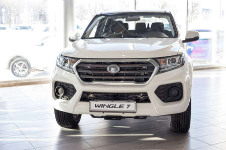 Russia, Izhevsk - February 17, 2021: Great Wall showroom. New modern Wingle 7 pickup in dealer showroom. Front view. Car manufacturer from China. Modern transportation. 新聞圖片