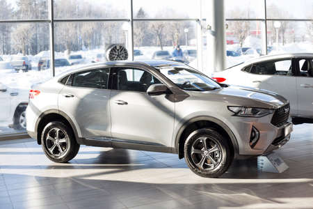 Russia, Izhevsk - February 17, 2021: Haval showroom. New modern F7X car in dealer showroom. Front and side view. Car manufacturer from China.