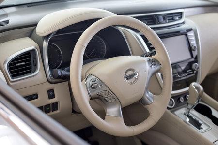 Russia, Izhevsk - February 19, 2021: Nissan showroom. Interior of new modern Murano car. Famous world brand. Modern transportation. 新聞圖片