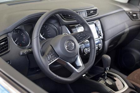 Russia, Izhevsk - February 19, 2021: Nissan showroom. Interior of new modern Qashqai car. Famous world brand. Modern transportation. 新聞圖片
