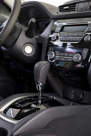 Interior of new modern unknown car with automatic transmission in dealer showroom. Modern transportation.