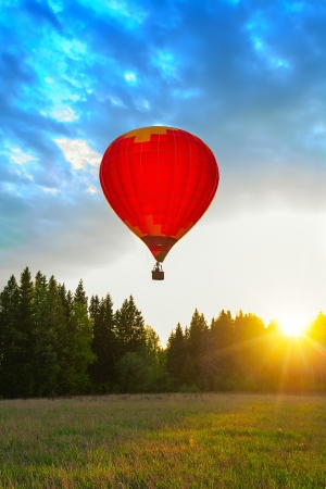 hot spring: Red balloon in sun beams